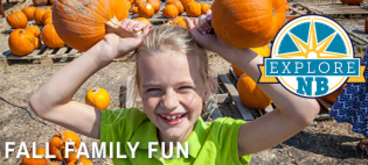 A young girl having fun at a pumpkin patch in New Braunfels, Texas