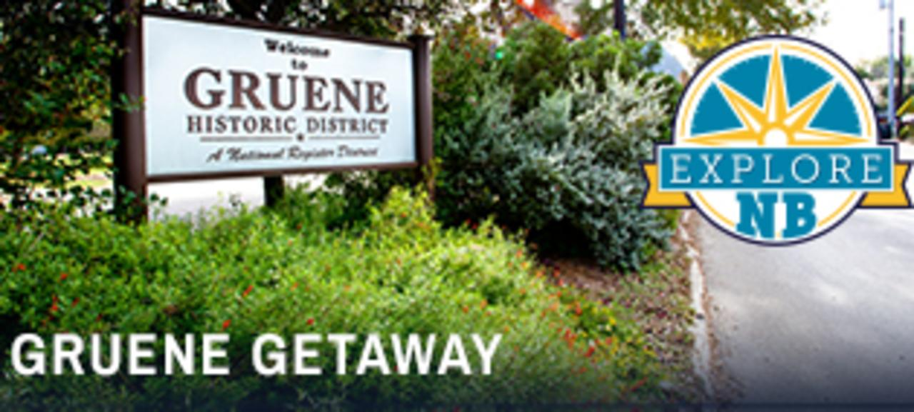"""A large sign reading """"Welcome to Gruene Historic District"""" is nestled among beautiful greenery in Gruene, Texas. The photo is accompanied by the """"Explore NB"""" logo."""