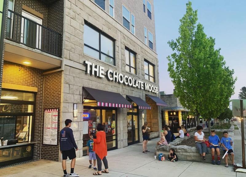 People enjoying ice cream outside of The Chocolate Moose