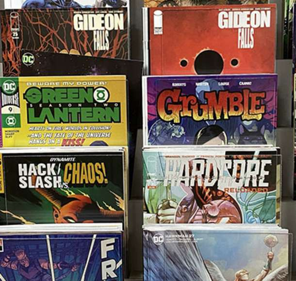 rack of comic books at elite comics in overland park