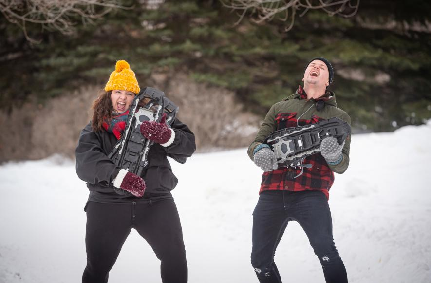 Visitors show off their snowshoes before heading into the woods outside of Saskatoon.