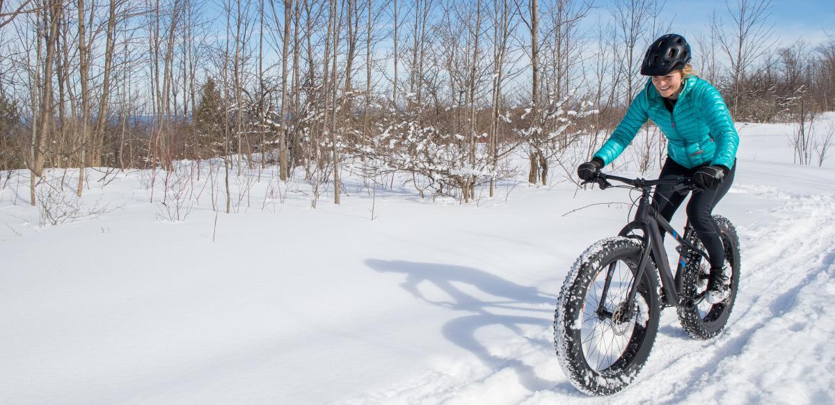 Woman Fat Biking in the snow in Boulder, Coloardo