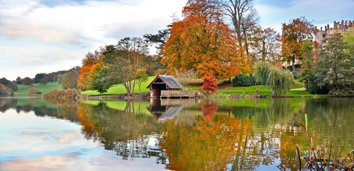 The boathouse and lake at Sherborne Castle, Dorset in autumn
