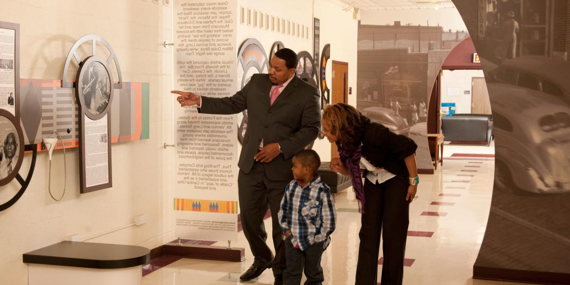 A family viewing art at the King Arts Complex