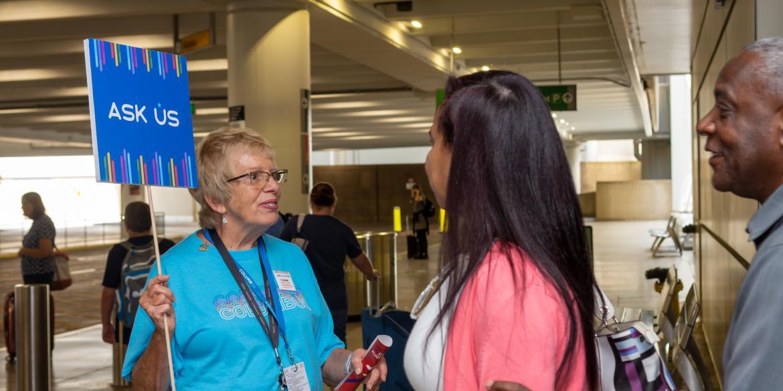 Volunteers welcoming meeting attendees at John Glenn Columbus