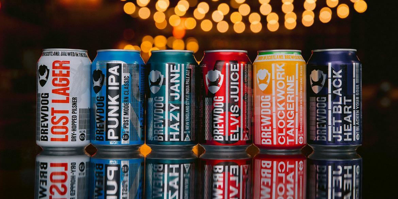 Array of BrewDog canned beer under string lights on bartop