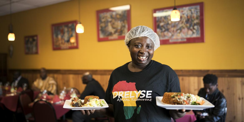 Serving food at Dreylse Africa Restaurant