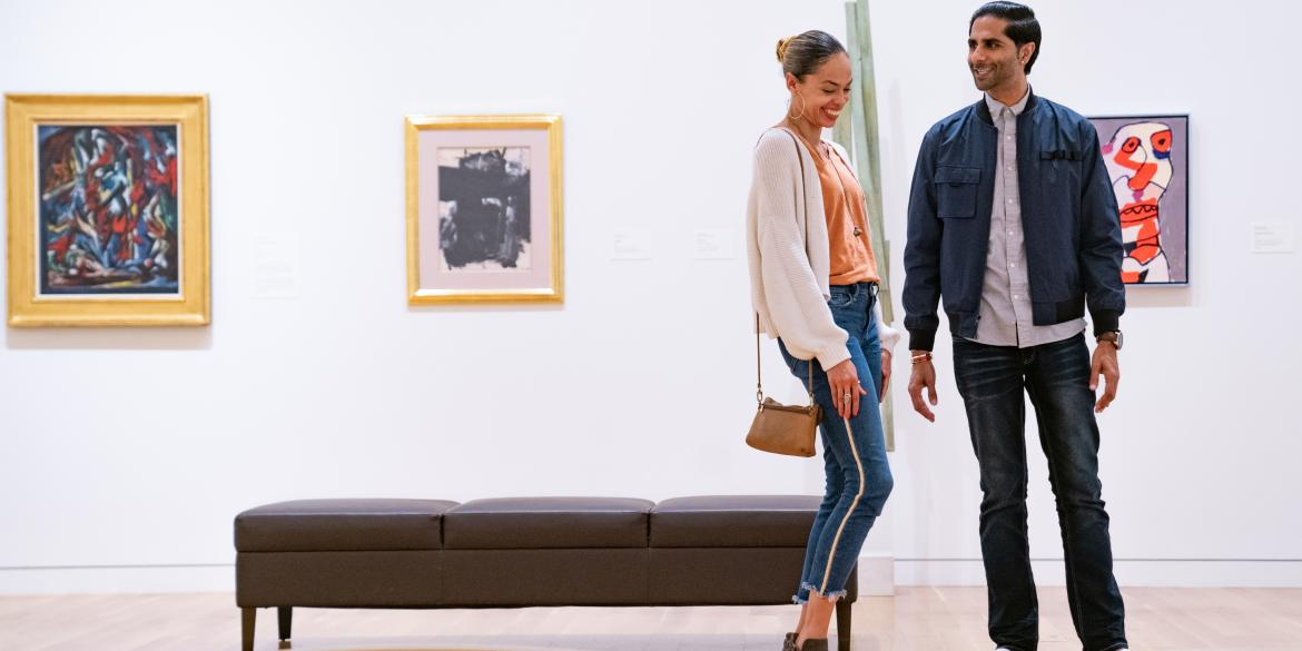 A couple exploring the Columbus Museum of Art.