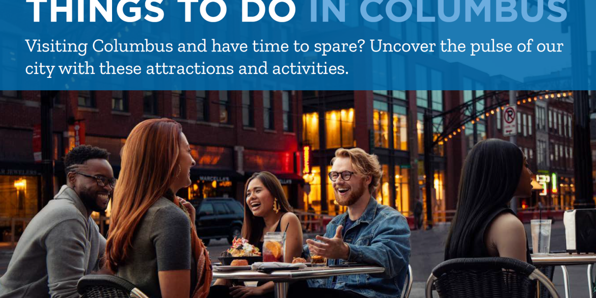 People Sitting At A Terrace With A Things To Do In Columbus Banner Above Them