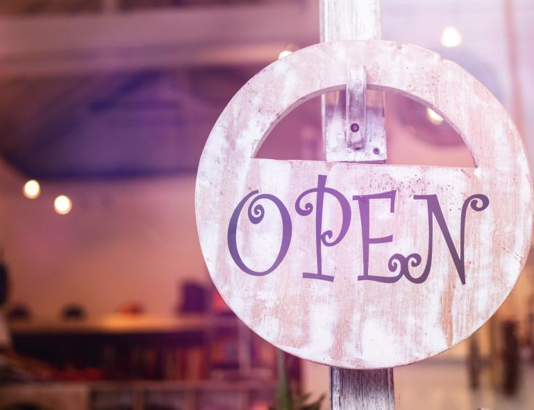 """An """"OPEN"""" sign hangs on a hook inside a window of a Cumberland Valley small business."""