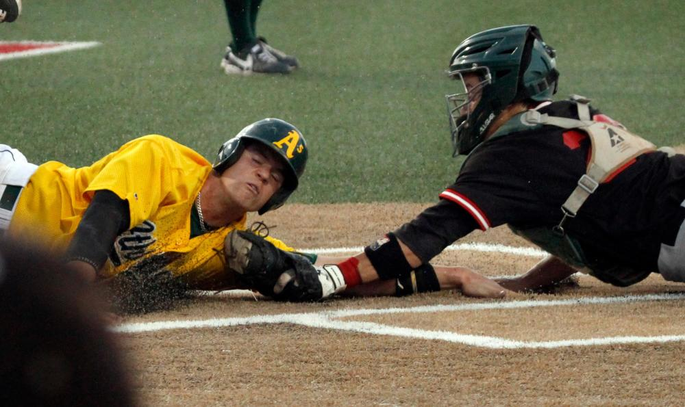 Arvada Player Slides Home While a Dodge City Catcher Tries to Tag in the 2016 NBC World Series