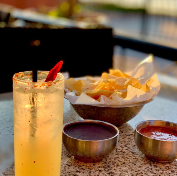 A cocktail along with chips and salsa at Gloria's Latin Cuisine in Irving, TX