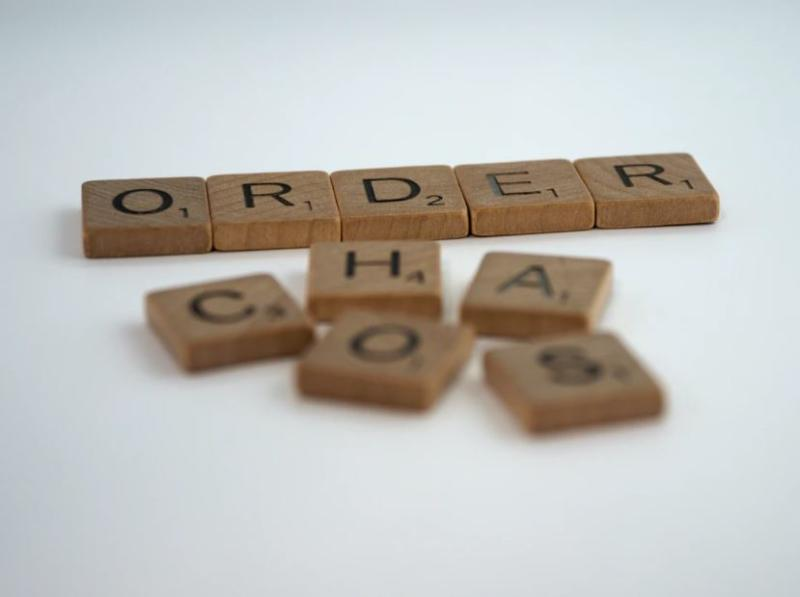 Scrabble tiles that spell Order and Chaos