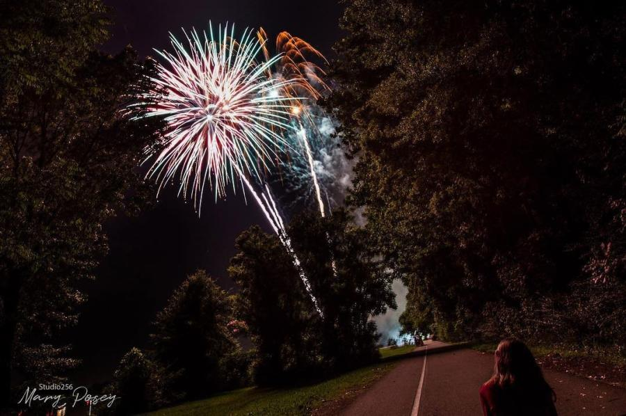 Fireworks on rural road through trees
