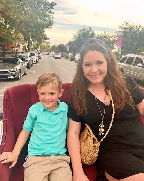Mom and young son on carriage ride in The Market Common