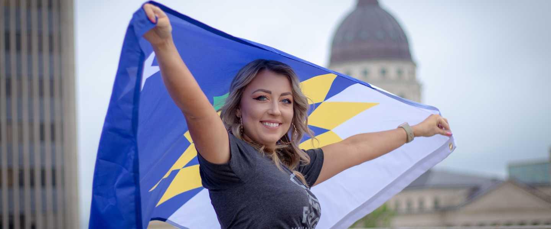 Topeka Flag Flying - Woman at Kansas State Capitol Building | Topeka, KS