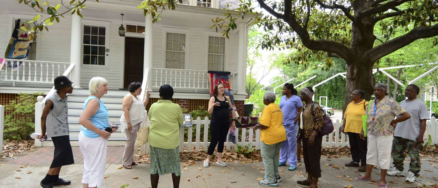 tour in front of Mann-Simons house