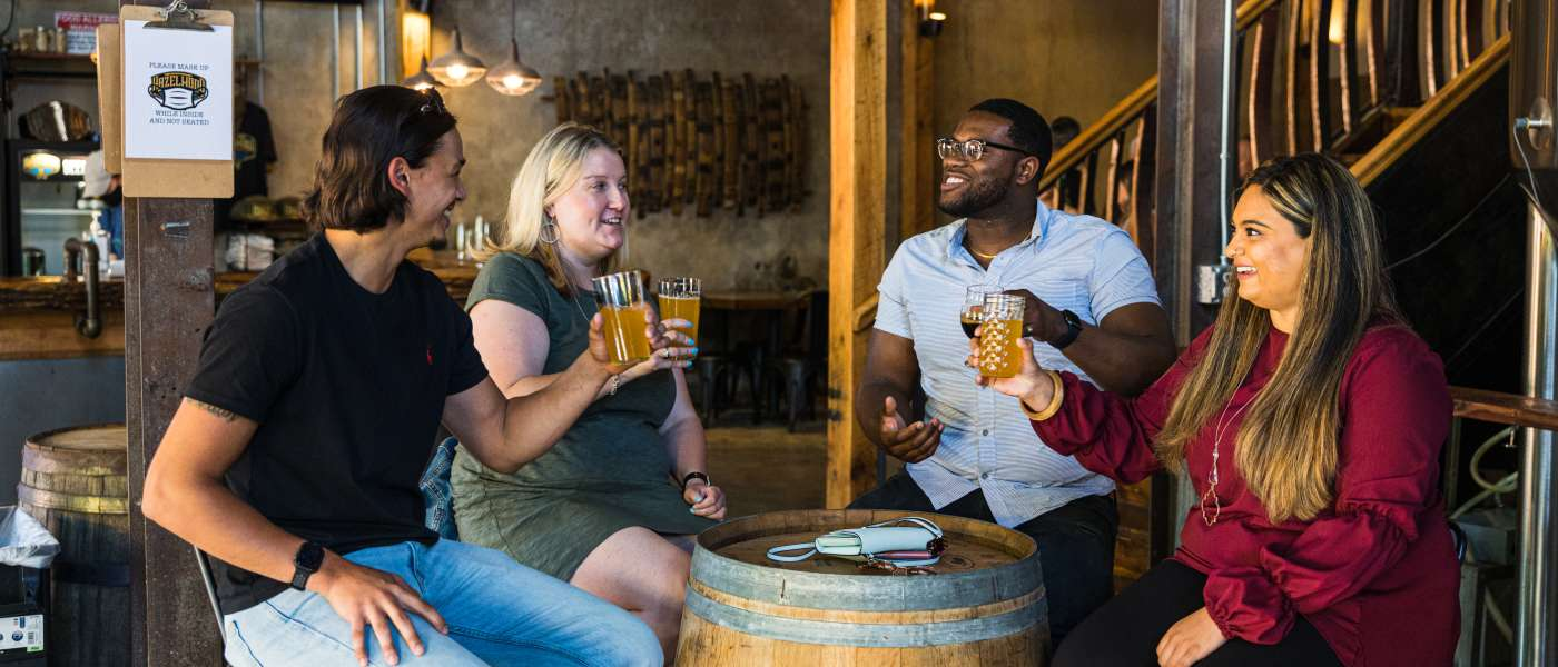Young adults drinking beer at a brewery