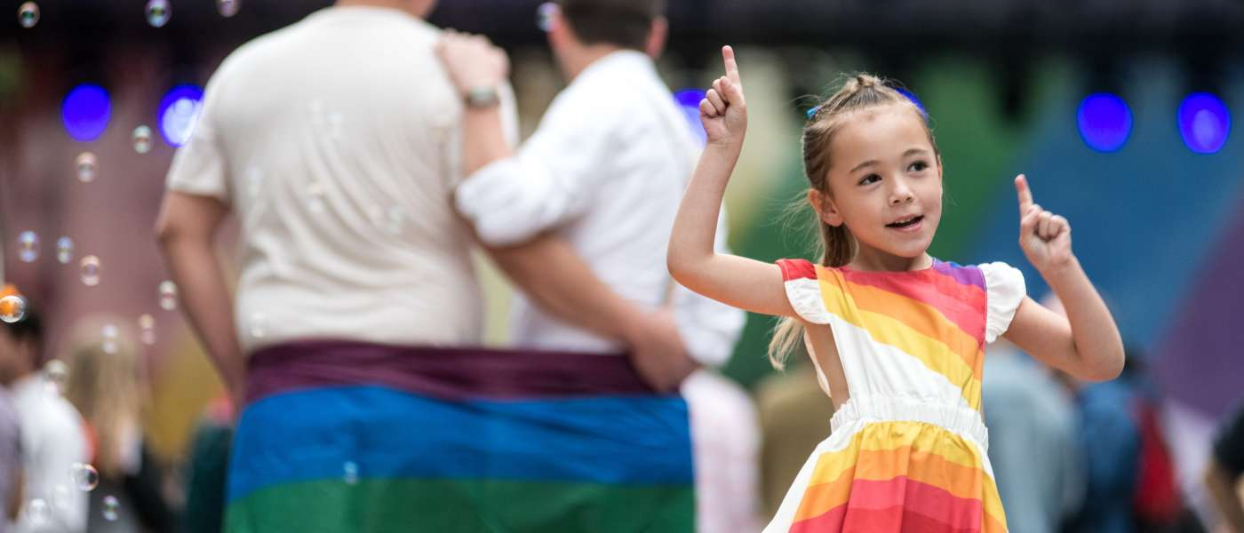 Child dancing in rainbow dress at the SC Pride Festival