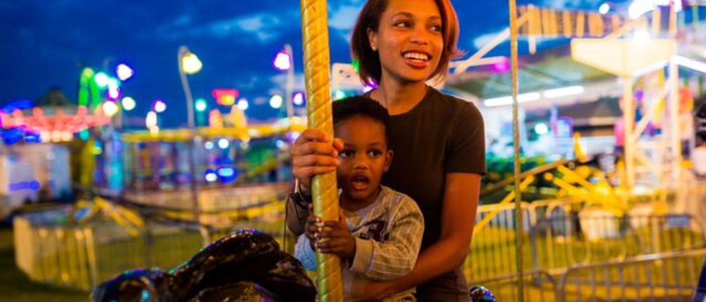 Mother and son ride carousel at SC State Fair