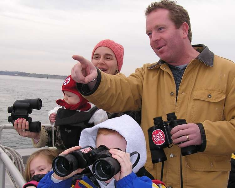 Family on Save The Bay Seal Watch Cruise (tour in Newport, photo can also represent Westerly cruises).