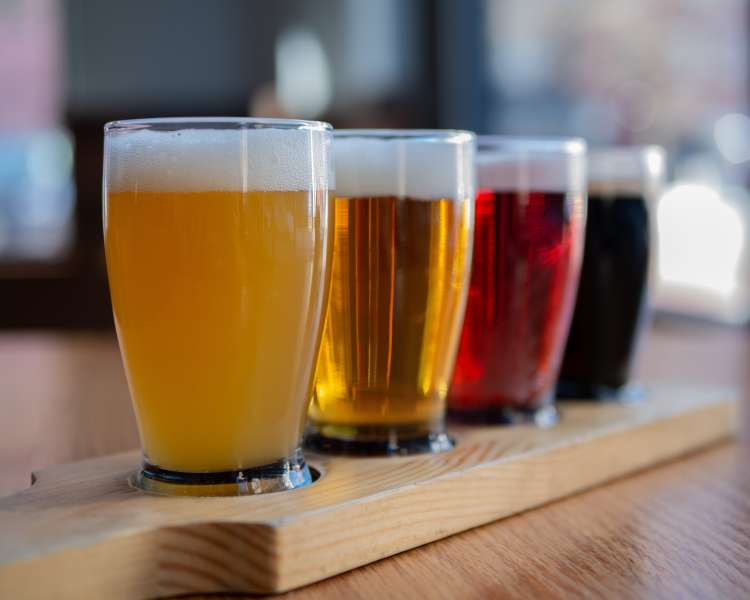 A flight of colorful beer.