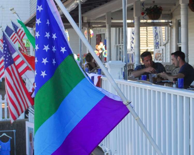 Flags hanging from the patio at The Harbor Grill.