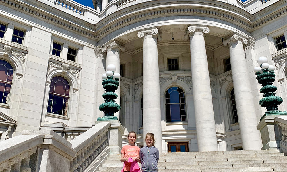 Children pose for a photo on the steps of the Wisconsin State Capitol