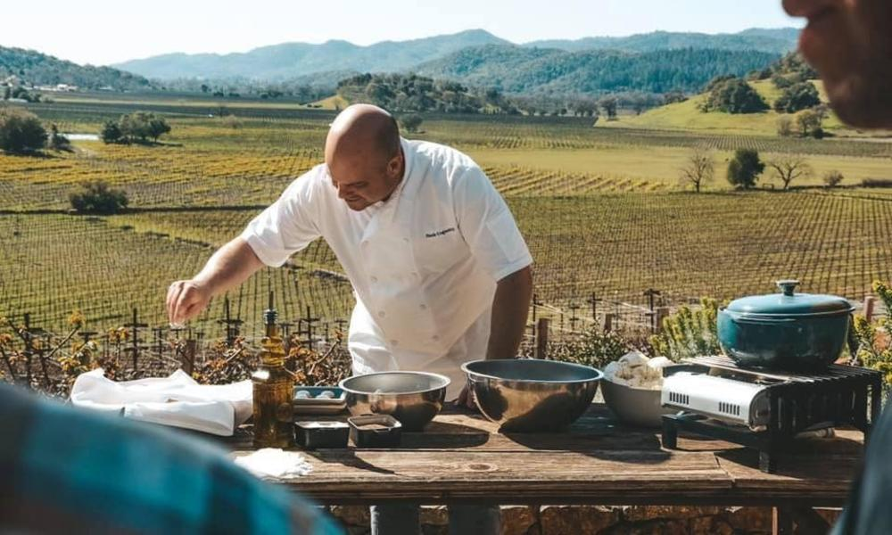 Chef Nash Live Cooking Class Outside In front of a Field