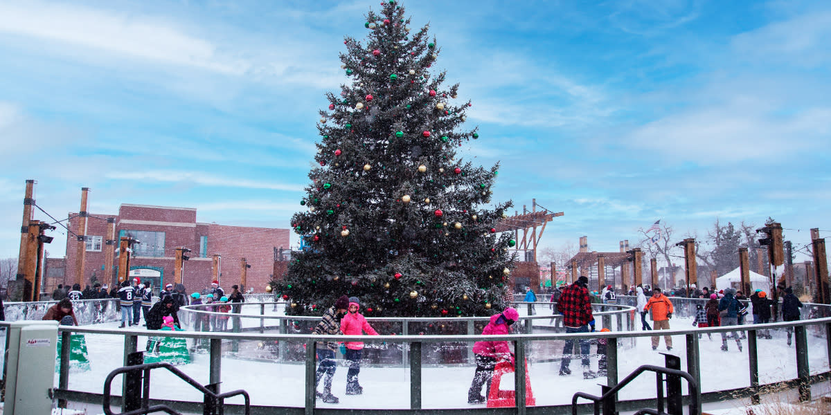 Outdoor ice skating around a pine tree with ornaments in downtown Casper, WY