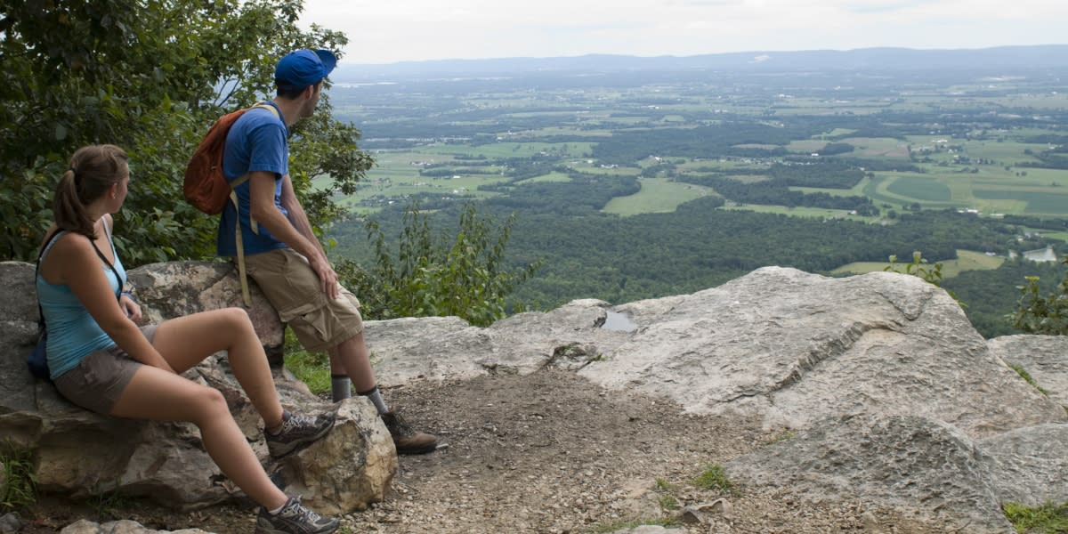 Couple Looking Out Over A Cliff In The Cumberland Valley