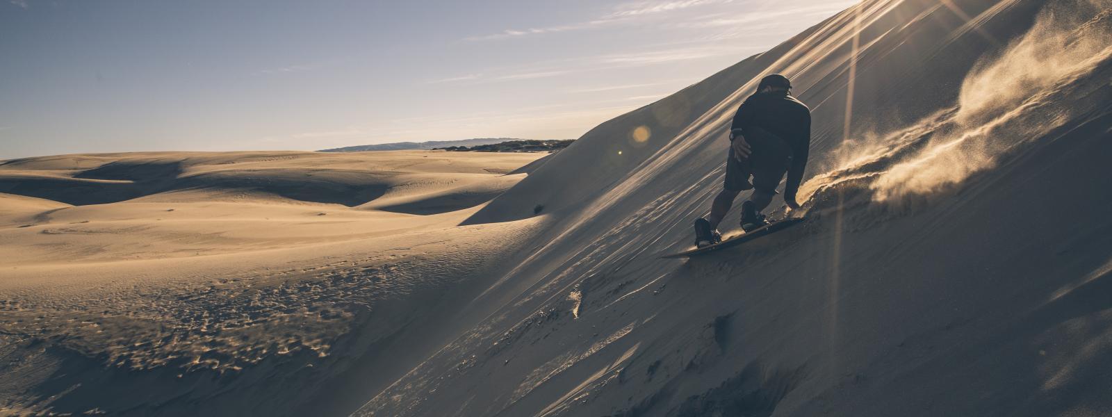 A Sandboarder, boarding down the Oceano Dunes