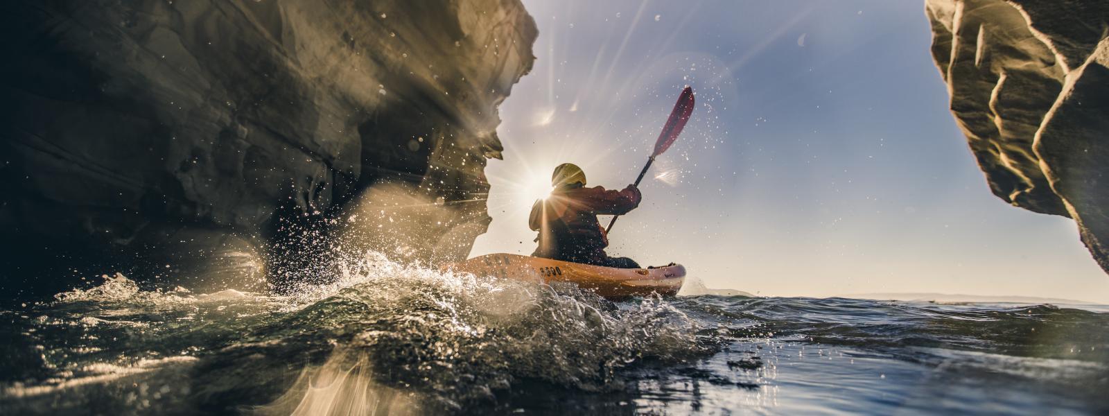 Kayaker In Dinosaur Caves
