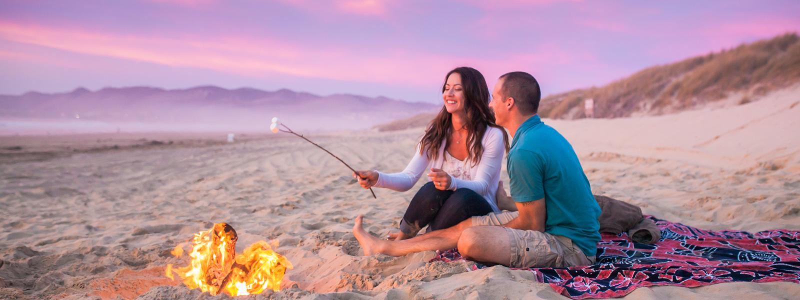 couple enjoying a bonfire on Grover Beach
