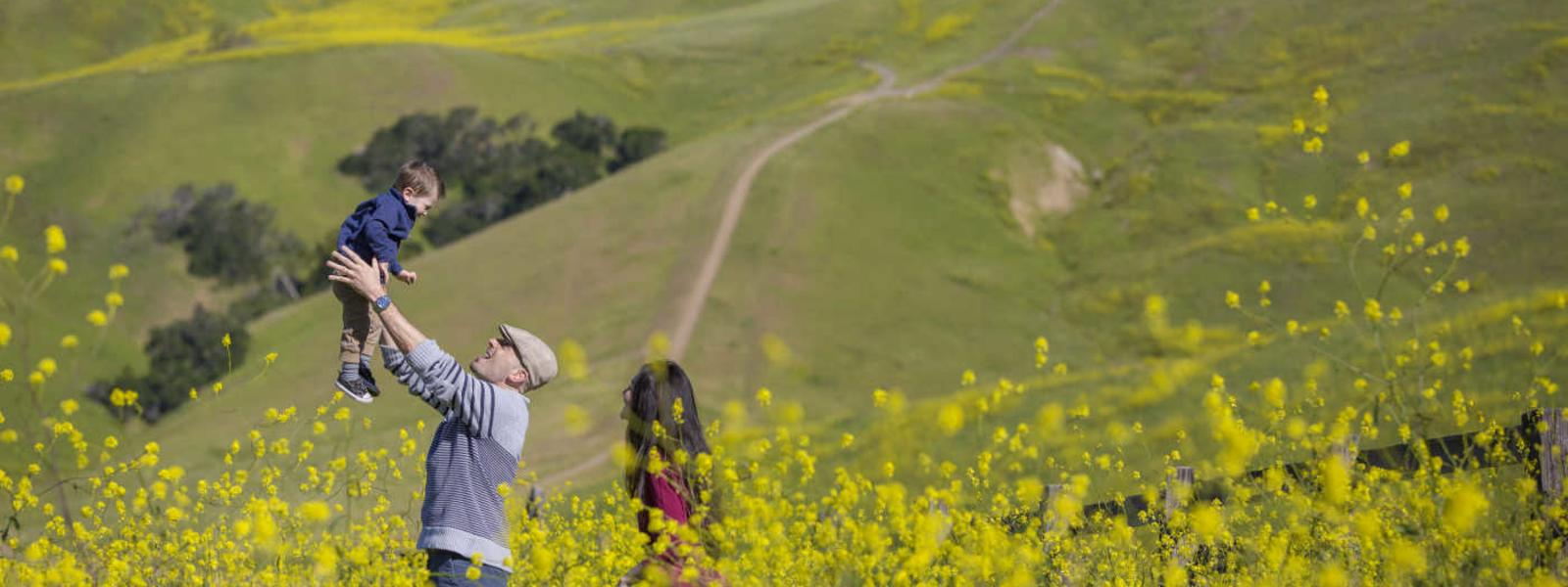 A family enjoys the wildflowers in the hills of SLO CAL