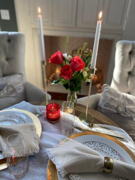 April's table offers a table setting complete their food and drink packages.