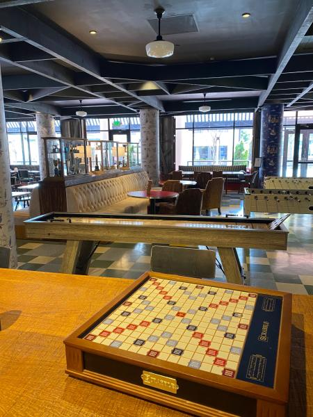 Scrabble and shuffle board and foosball can be played at the Trophy Room at the Graduate Annapolis