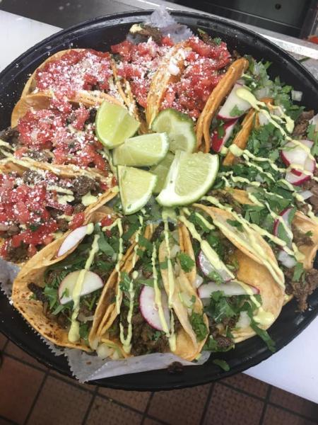 tray of tacos with limes in the middle of a circle from lita's tacos in florence kentucky