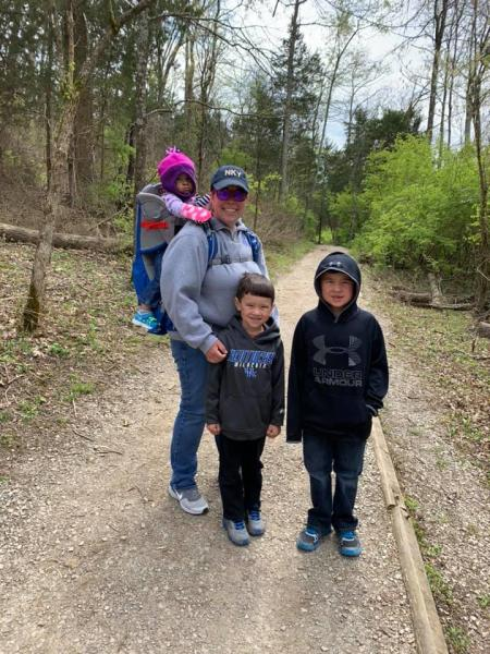 mother with three kids hiking at big bone lick state historic site