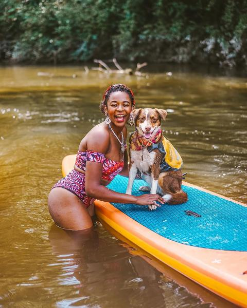 Woman With Dog Stand-up paddling on the Bogue Falaya River with Canoe and Trail Adventures