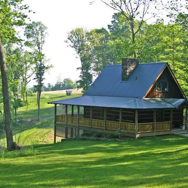 Exterior view of a cabin with a wrap around porch