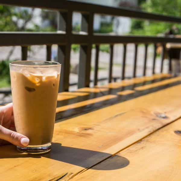 Two people enjoying iced coffee from Hopscotch Coffee