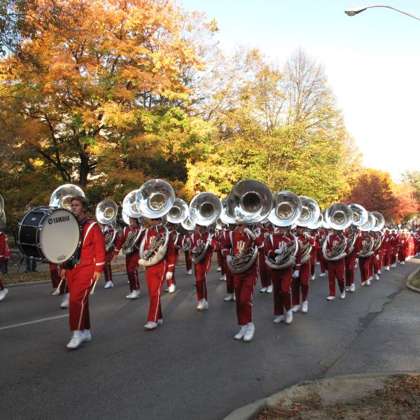 Marching band in uniform and playing their instruments at the IU Homecoming Parade