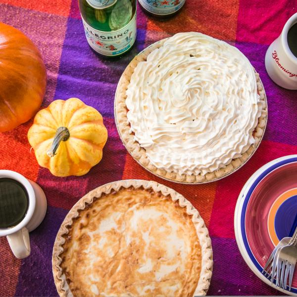 Pumpkin pie with whipped cream on an autumn themed table