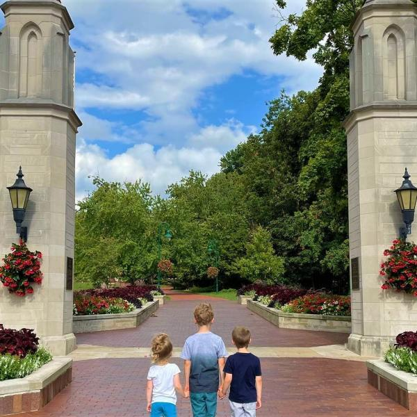 Three small kids holding hands at Sample Gates
