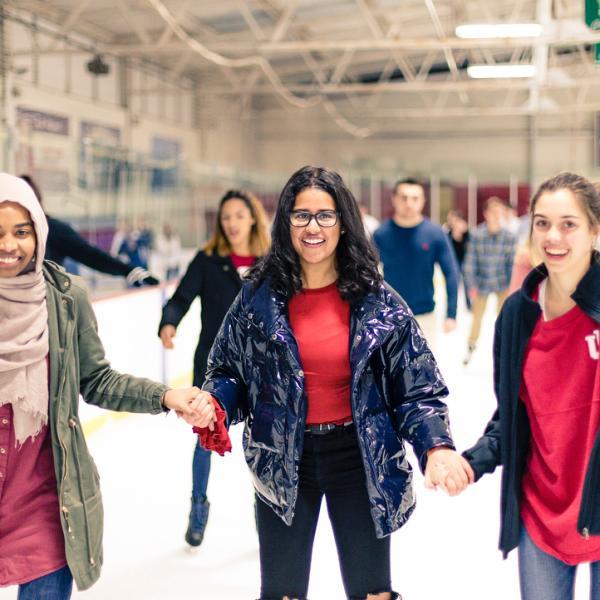 Three girls ice skating at Frank Southern Ice Arena