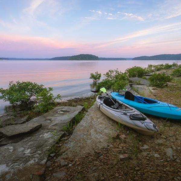 Two kayaks on the shore of Monroe Lake in the Hoosier National Forest