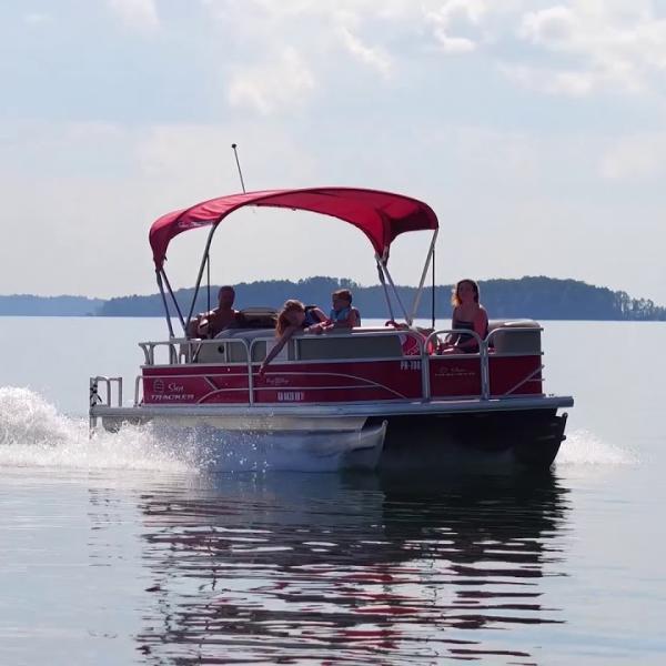 Red pontoon boat on Monroe Lake