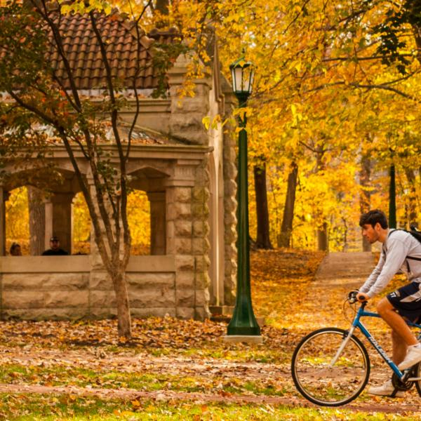 College students biking/walking on the Indiana University campus in the fall