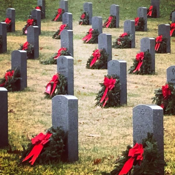 Christmas wreaths placed in front of tombstone at Quantico National Cemetery